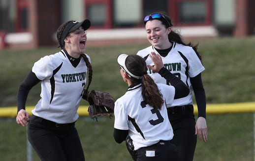 From right, Yorktown's Sam Riccardulli having some fun with teammates in the outfield during recent game at Yorktown High School April 4, 2019.