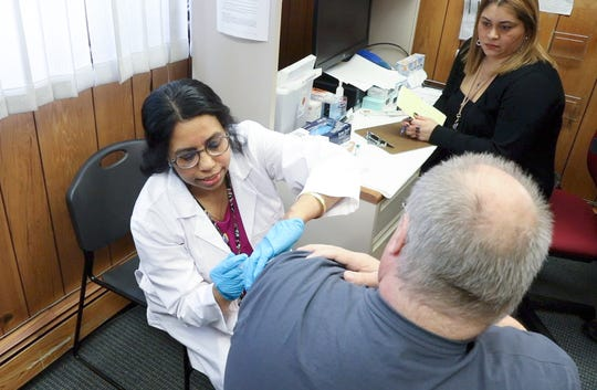Dept. of Health nurse Sheela Geevarghese, left, administers the MMR booster to Jeff Sterling of Nyack during a measles (MMR) vaccination clinic at WIC Office in  Haverstraw on Friday, April 5, 2019.