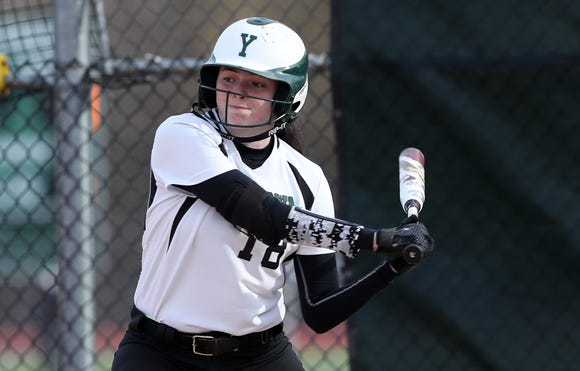 Yorktown center fielder Sam Riccardulli swings at a pitch during a softball game against John Jay-East Fishkill on Apr. 4, 2019.