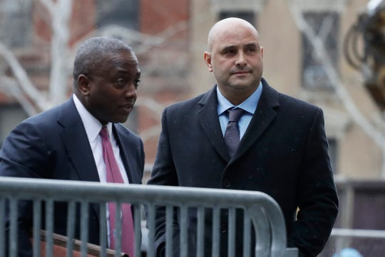 Craig Carton, right, the former co-host of a sports radio show with ex-NFL quarterback Boomer Esiason, arrives at federal court to be sentenced for defrauding investors in a ticket reselling business, Friday, April 5, 2019, in New York.