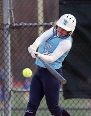 John Jay (EF) Kelly Rattigan hits an rbi single against Yorktown during softball action at Yorktown High School April 4, 2019. John Jay won the game 17-0.