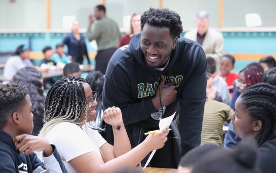 A Kakiat STEAM Academy eighth-grader gets help with a writing exercise from author Nana Kwame Adjei-Brenyah, a Spring Valley native, on April 5, 2019.