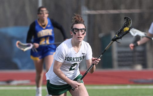 Yorktown's Noelle Cegielski carries the ball during a game against Mahopac April 4, 2019.