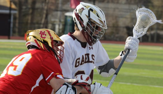 Bergen Catholic's Michael	Kearney (19) guards Iona Prep's John Schreiber (24) during boys lacrosse game at Iona Prep School in New Rochelle April 4, 2019. Iona Prep defeats Bergen Catholic 11-10.