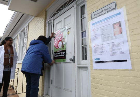 Workers with the Rockland County (New York) Department of Health display posters during a measles (MMR) vaccination clinic at WIC office in Haverstraw, New York, on Friday, April 5, 2019.