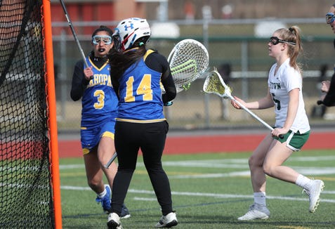 Yorktown's Kelsey McDonnell (15) scores a first half goal against Mahopac during girls lacrosse action at Yorktown High School April 4, 2019. Yorktown won the game 14-4.