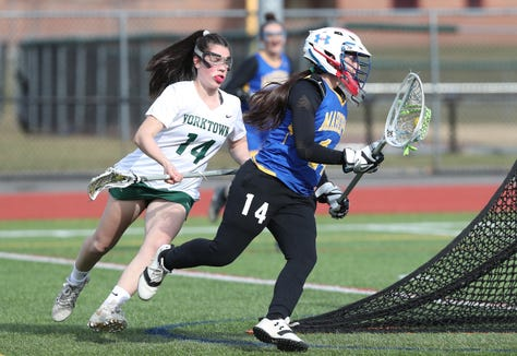Yorktown's Alexa Borges chases Mahopac goalie Jordan Barbagallo during Yorktown's 14-4 win over Mahopac April 4, 2019.