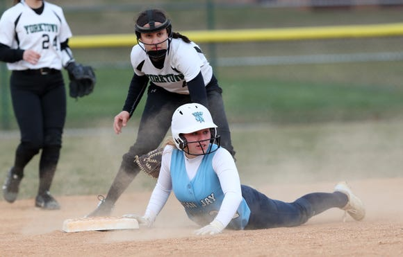 John Jay (EF) Kelly Rattigan slides safe into second with an rbi double against Yorktown during softball action at Yorktown High School April 4, 2019. John Jay won the game 17-0.