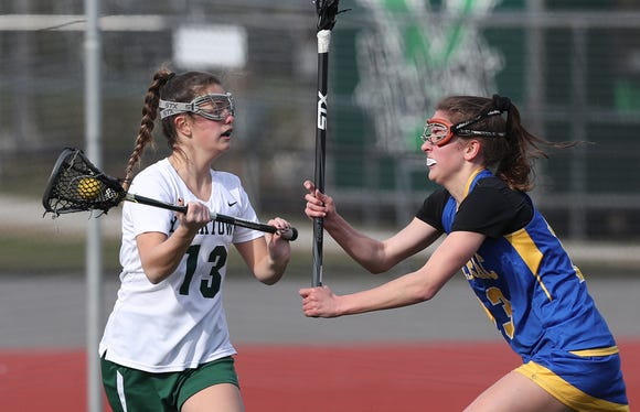 Yorktown's Maddy Marr (l) is guarded by Mahopac's Colleen MacNeil during an April 4, 2019 game. Yorktown won 14-4.