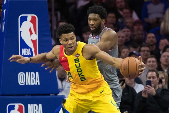 Apr 4, 2019; Philadelphia, PA, USA; Milwaukee Bucks forward Giannis Antetokounmpo (34) handles the ball against Philadelphia 76ers center Joel Embiid (21) during the second quarter at Wells Fargo Center.