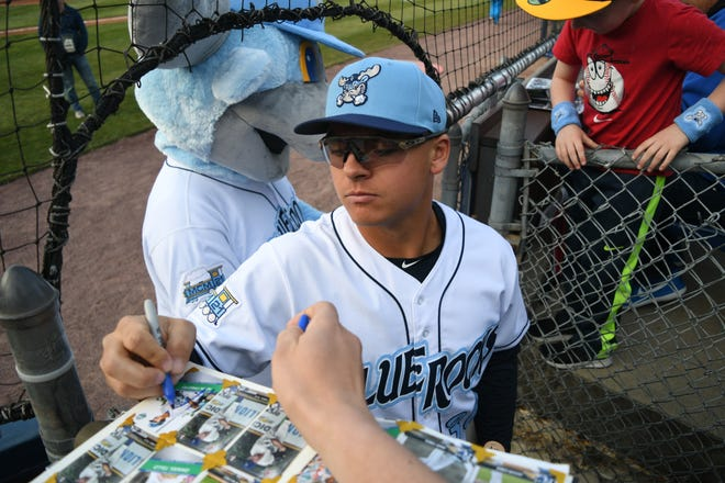 Blue Rocks First Basemen Nick Pratto signs autographs for fans before the start of their season opener versus the Salem Red Sox Thursday.