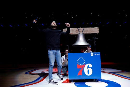 Philadelphia Phillies' Bryce Harper is introduced before an NBA basketball game between the Philadelphia 76ers and the Milwaukee Bucks, on Thursday, April 4, 2019, in Philadelphia.