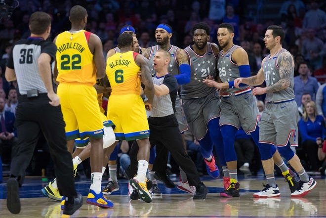 Apr 4, 2019; Philadelphia, PA, USA; Philadelphia 76ers center Joel Embiid (21) and Milwaukee Bucks guard Eric Bledsoe (6) are held back during an altercation in the first quarter at Wells Fargo Center.