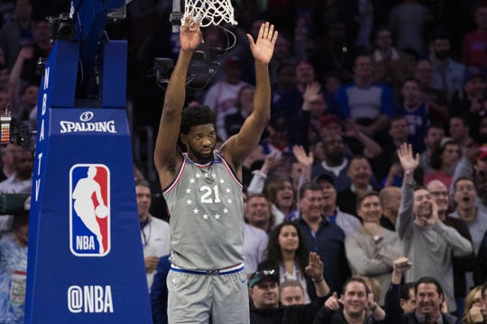 Apr 4, 2019; Philadelphia, PA, USA; Philadelphia 76ers center Joel Embiid (21) waves bye to Milwaukee Bucks guard Eric Bledsoe (not pictured) after Bledsoe is ejected during the first quarter at Wells Fargo Center.