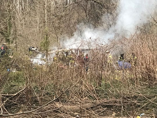 Firefighters at the scene of a fire along Red Clay Creek near Powell Ford Park.