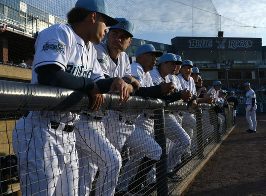 Wilmington Blue Rocks players await player introductions before their game Thursday, the Frawley Stadium season opener.