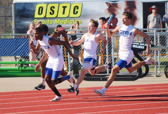 The City View and Childress 4x100 meter relay teams complete their hand-offs at the 8-3A District track meet held in City View. City View was first place in the relay.