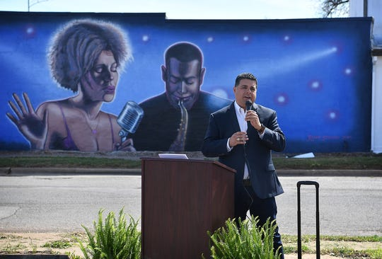 Wichita Falls Mayor Stephen Santellana speaks Friday morning at the enveiling of a new mural at 811 Homes Avenue on the east side of Wichita Falls. Artist Ralph Stearns painted the image which depicts a jazz singer and musician and is inspired by the rich musical history from the area.