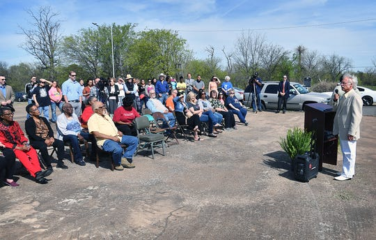 Artist Ralph Stearns speaks to a crowd gathered at the unveiling of his latest community mural Friday morning at the corner of Flood Street and Homes Avenue on the east side of Wichita Falls.