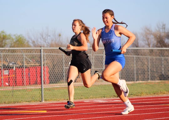 Runners from the Childress and Henrietta compete in the varsity girls 4x200 meter relay.