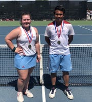 Hirschi's Savana Mayfield  and Zach Leon won district singles titles Friday in Graham.