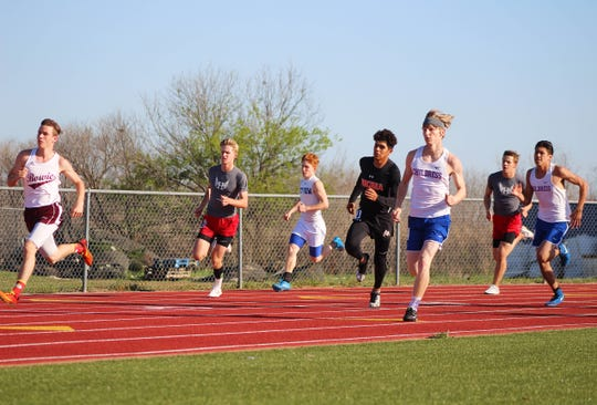Varsity runners compete in the 800-meter run at the 8-3A District track meet held on April 4, 2019.