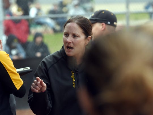 Tri-Valley coach Laura Seward encourages her team between innings against Philo.
