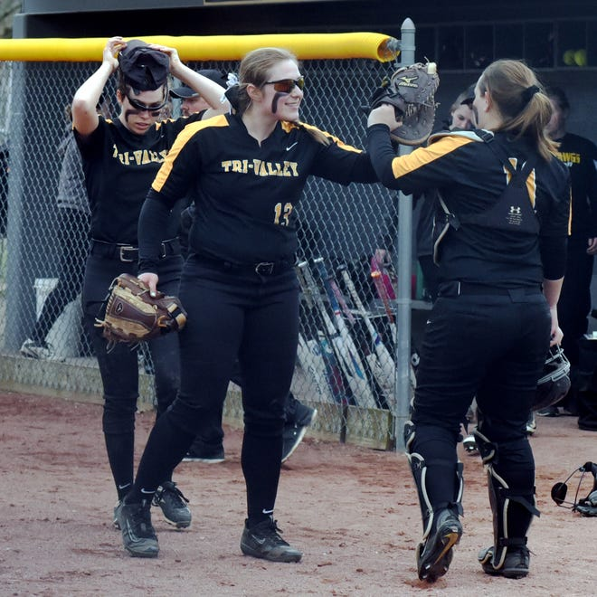 Tri-Valley pitcher Janessa Dawson is congratulated by catcher Cheyenne Coleman after recording the final out of a 5-2 win against Philo on Wednesday at Kenny Wolford Park. Dawson struck out nine in a complete game.