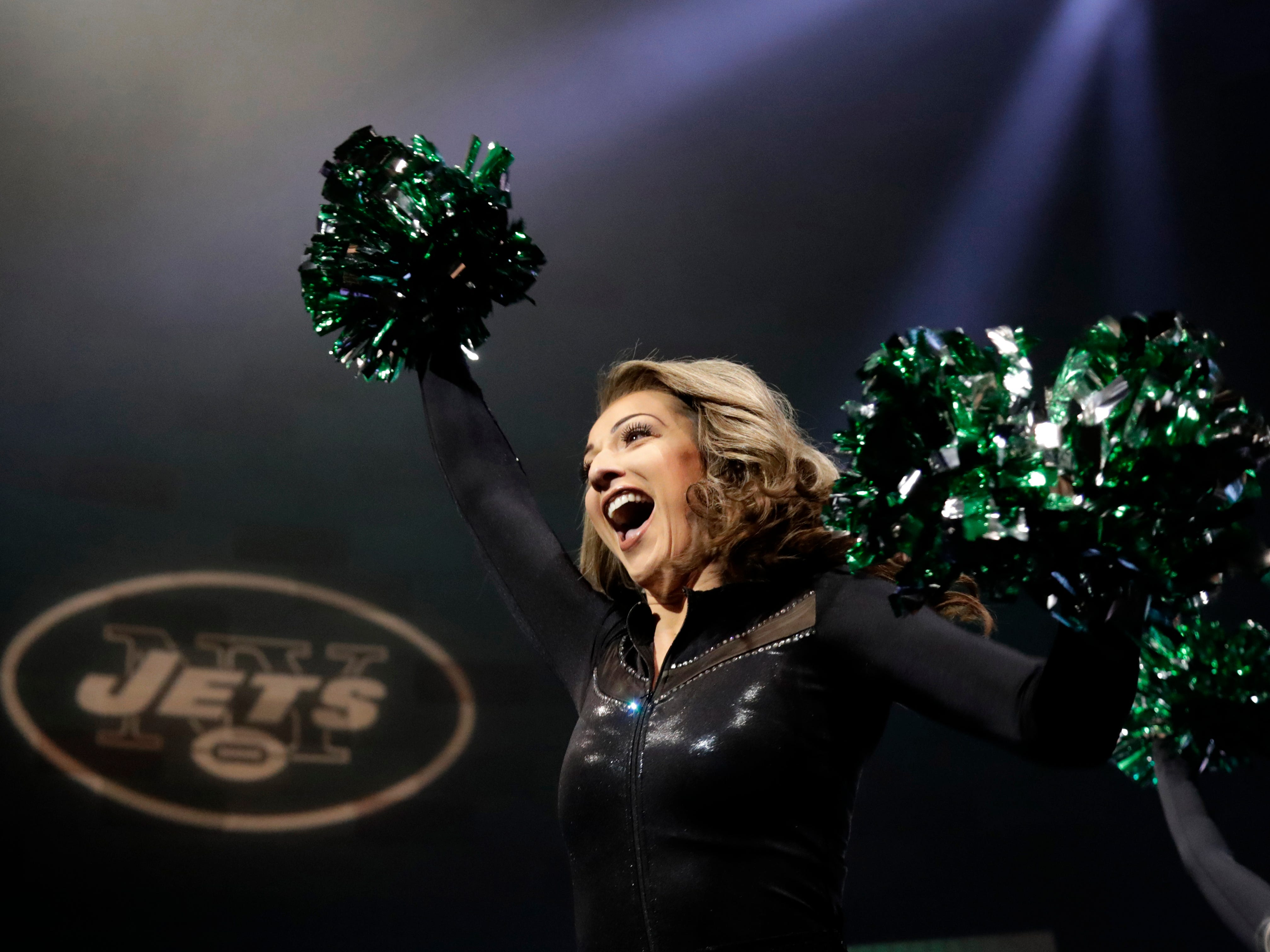 A member of the New York Jets Flight Crew performs during an event unveiling the team's new uniforms.