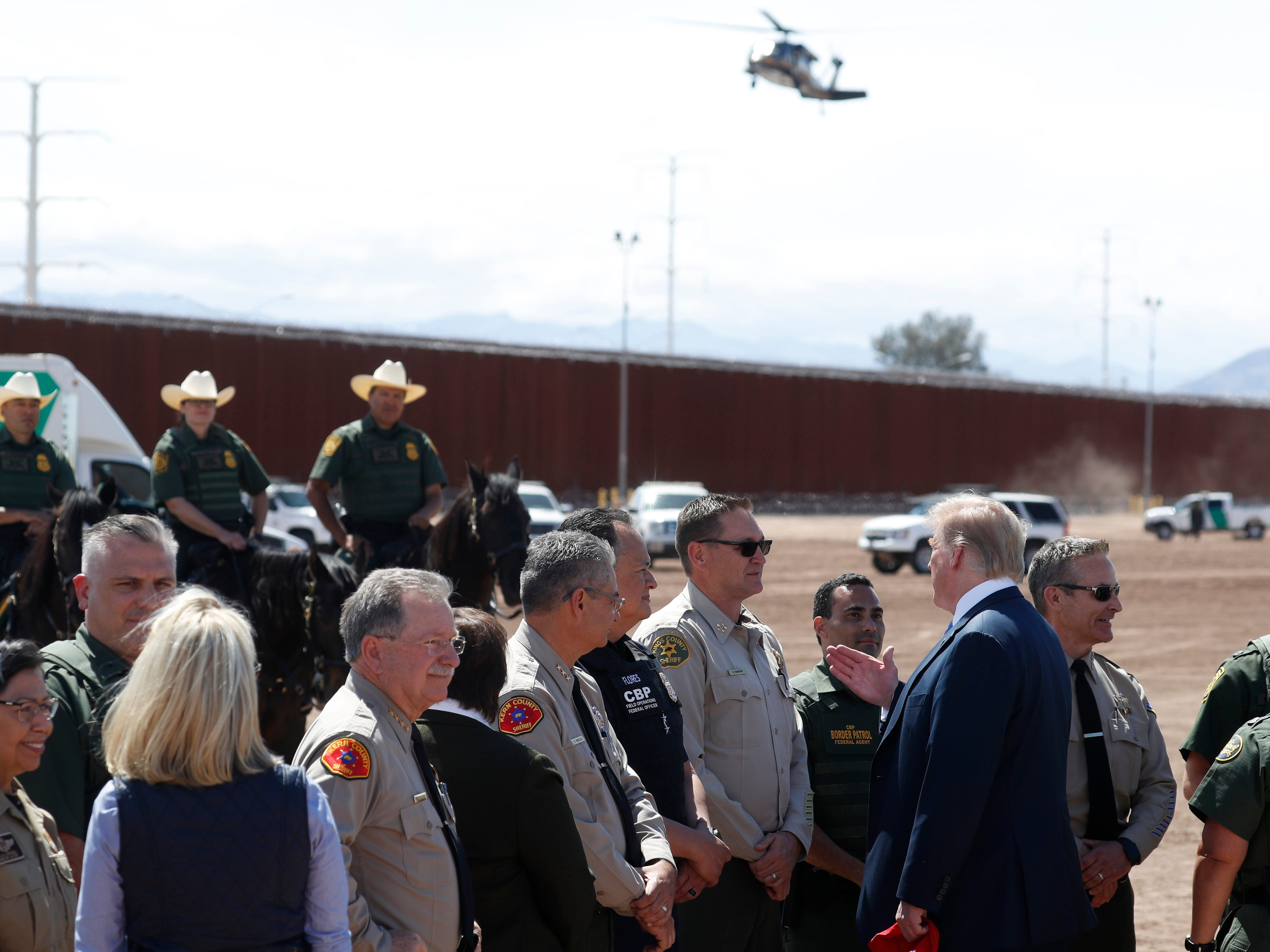 President Donald Trump visits a new section of the border wall with Mexico in Calexico, Calif., Friday April 5, 2019.