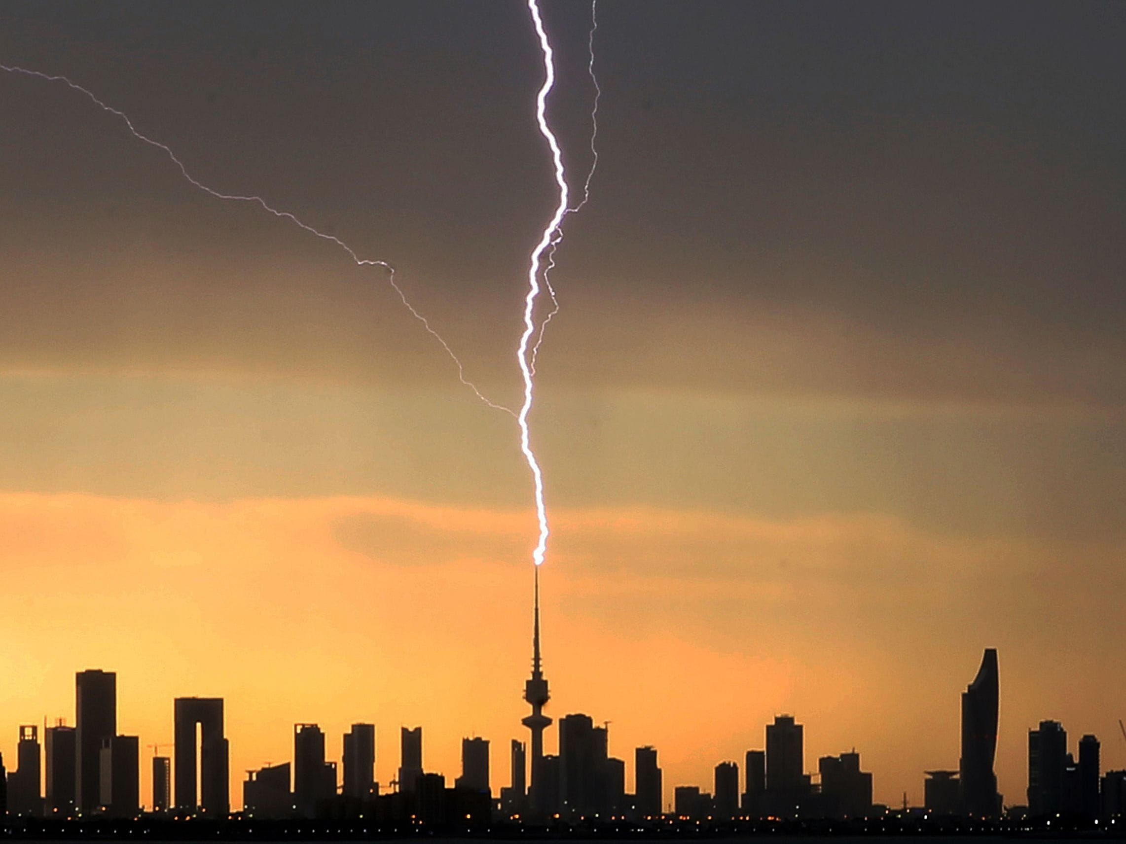 Lightning strikes the liberation tower in Kuwait City during a thunder storm on April 5, 2019.