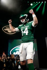 QB Sam Darnold models the Jets' new uniforms, which drew harsh reaction on social media.