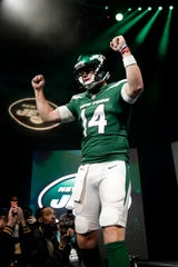b095023e2be QB Sam Darnold models the Jets' new uniforms, which drew harsh reaction on  social