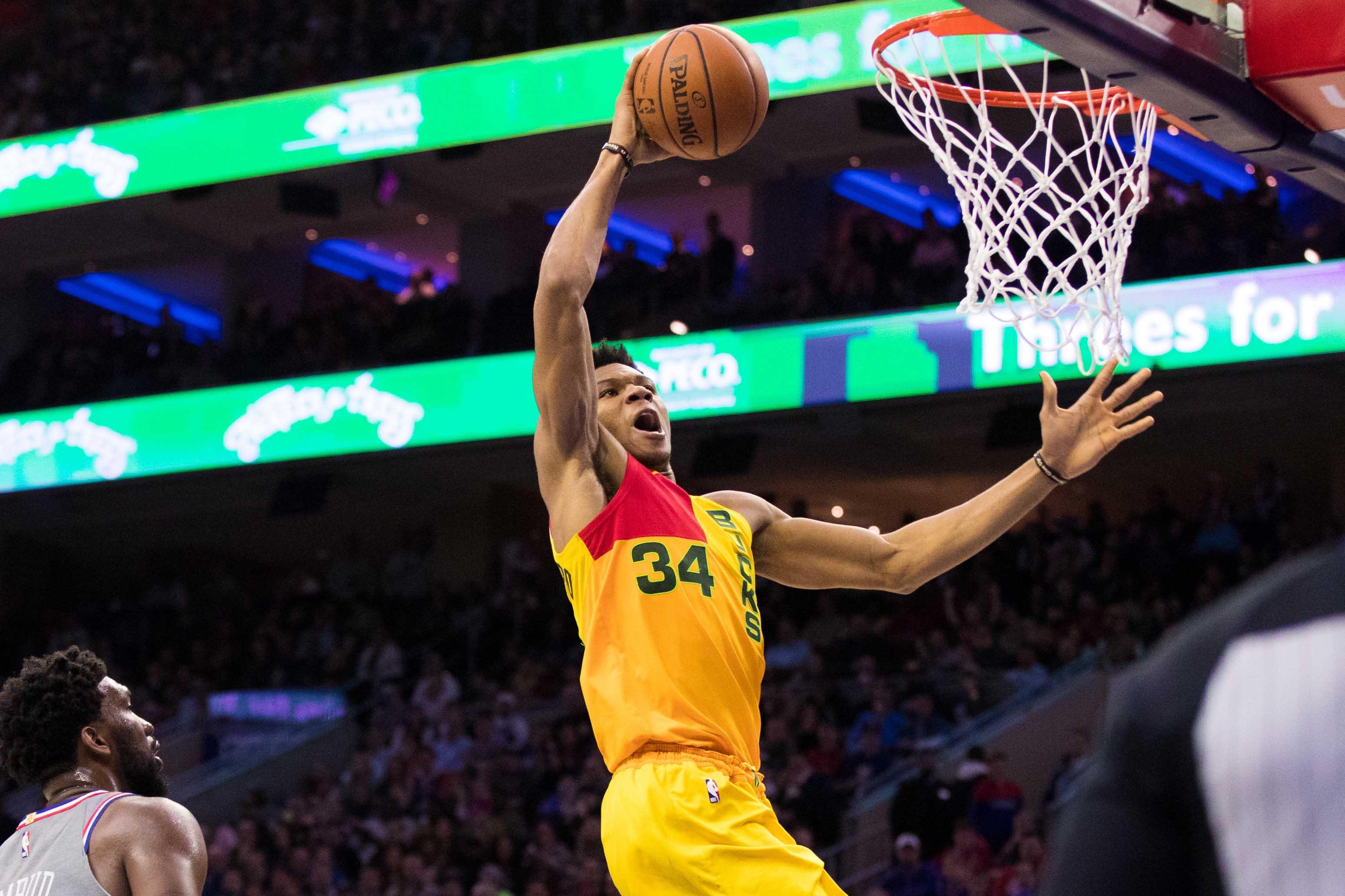 Giannis Antetokounmpo dominates, Bucks surge past 76ers to clinch NBA's best record