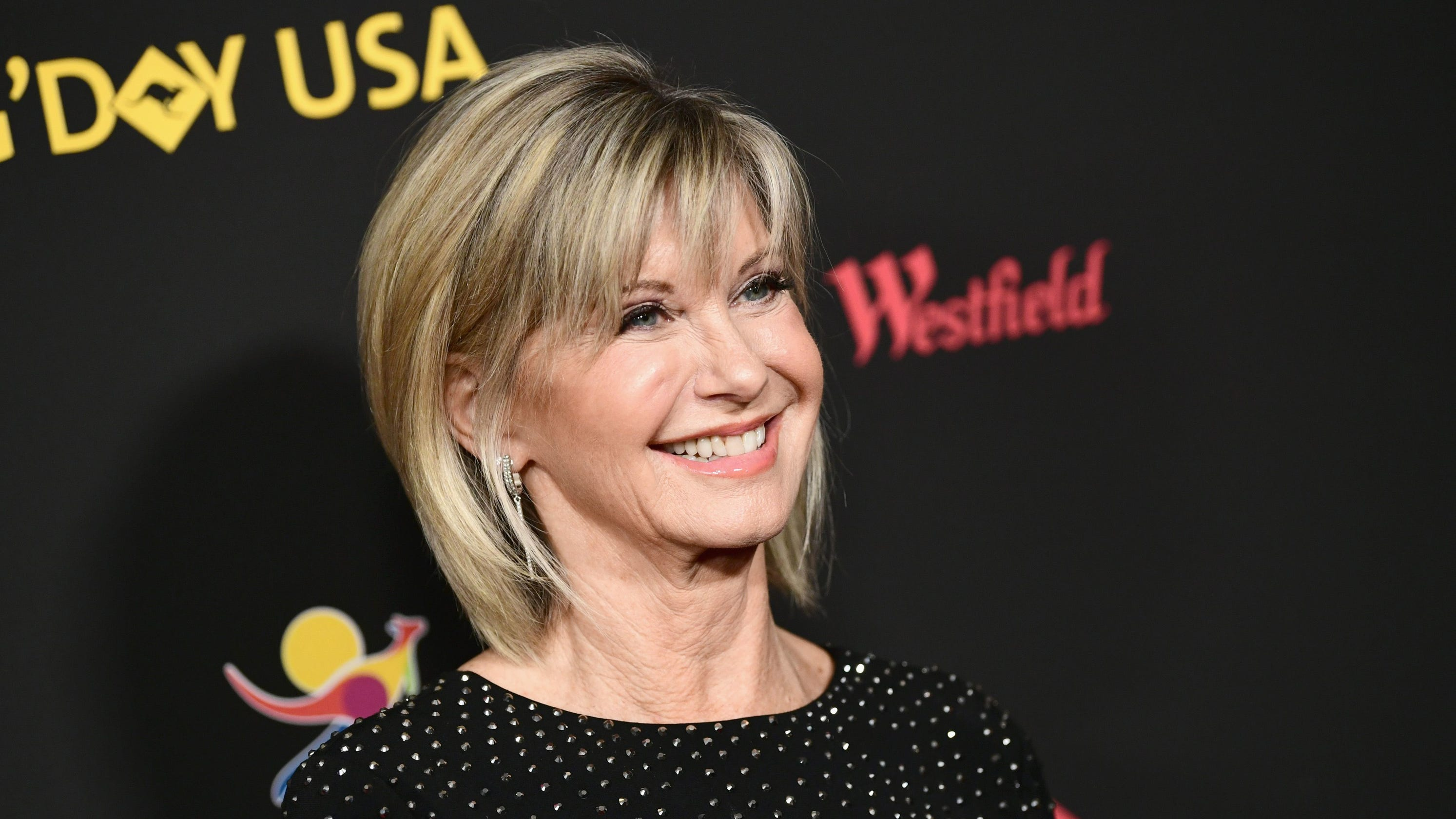 Olivia Newton-John, battling cancer, uses 'a lot of cannabis' to heal