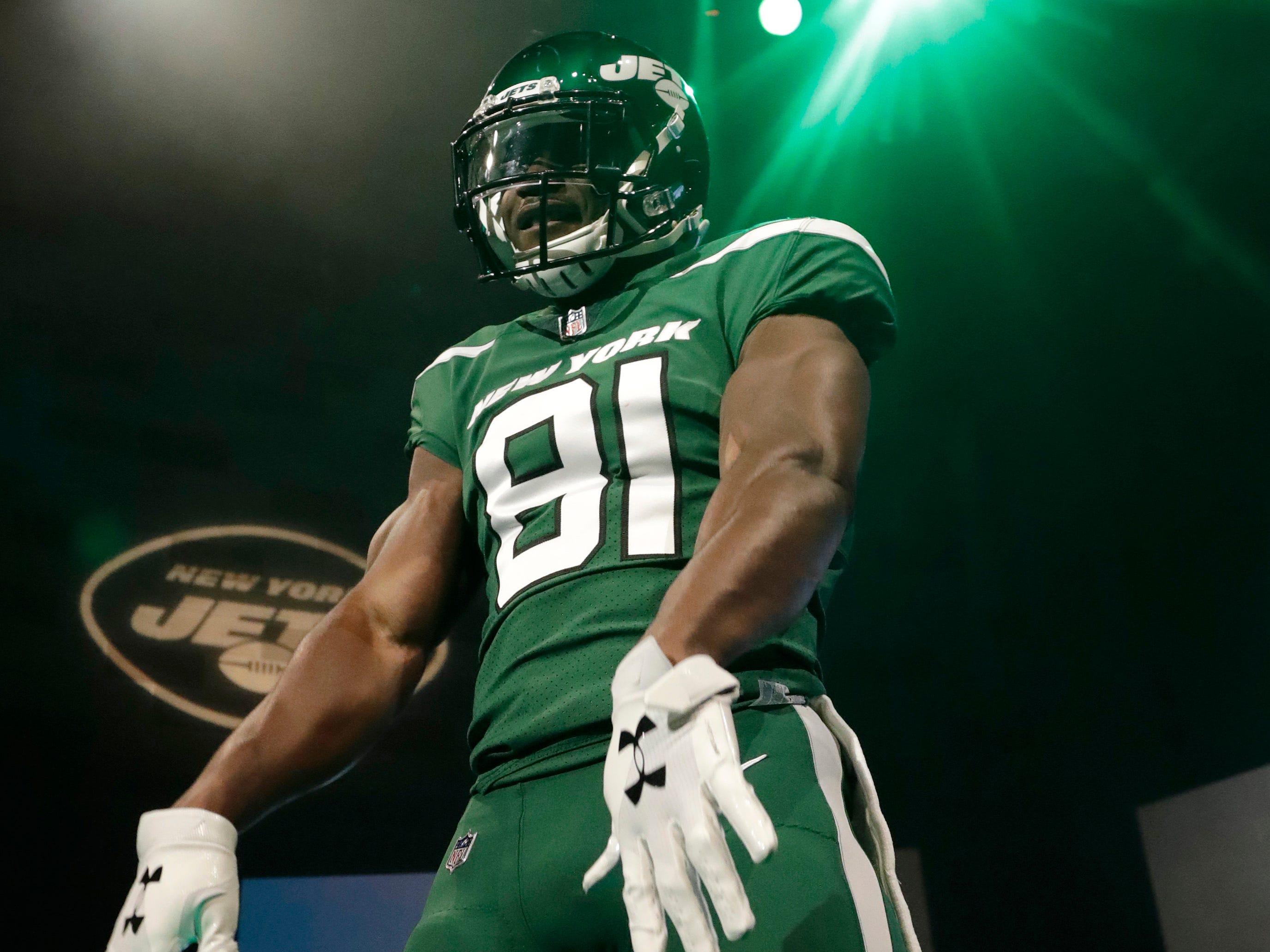 "New York Jets wide receiver Quincy Enunwa models the team's new ""Gotham green"" uniform."