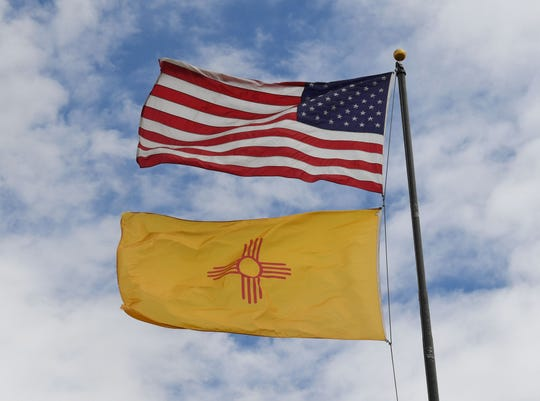 In this file photo taken on October 01, 2018 The US and New Mexico flags fly before the upcoming mid-term elections in Albuquerque, New Mexico.