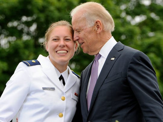 FILE - In this May 22, 2013 file photo, Newly commissioned officer Erin Talbot, left, poses for a photograph with Vice President Joe Biden during commencement for the United States Coast Guard Academy in New London, Conn. As former Vice President Biden's camp scrambles to contain any political damage over his past behavior with women, House Speaker Nancy Pelosi has some words of advice: Keep your distance.  (AP Photo/Jessica Hill) ORG XMIT: WX121