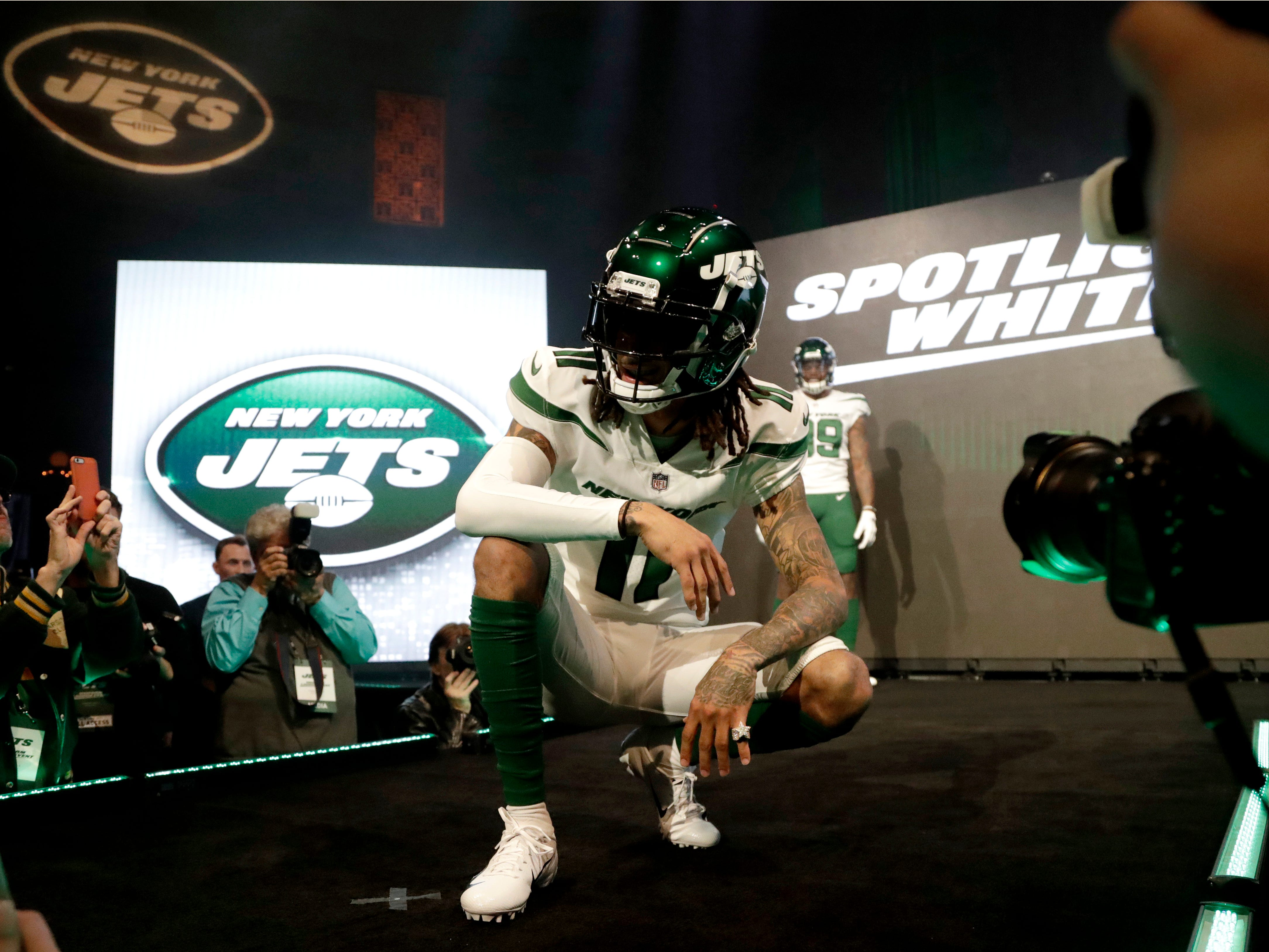 """New York Jets wide receiver Robby Anderson models the team's new """"spotlight white"""" uniform."""