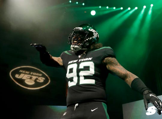 "New York Jets defensive end Leonard Williams models the NFL football team's new ""stealth black"" uniform Thursday, April 4, 2019, in New York."