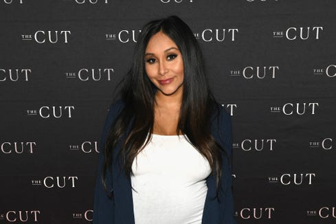 Snooki heard from critics after using strollers during a trip to Disney World.