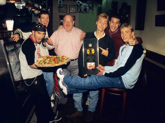 Boy-band creator Lou Perlman died in 2016 in prison while serving a 25-year sentence for a Ponzi scheme. He's shown here in 1996 with NSYNC's Chris Kirkpatrick, JC Chasez, Lance Bass, Joey Fatone and Justin Timberlake.