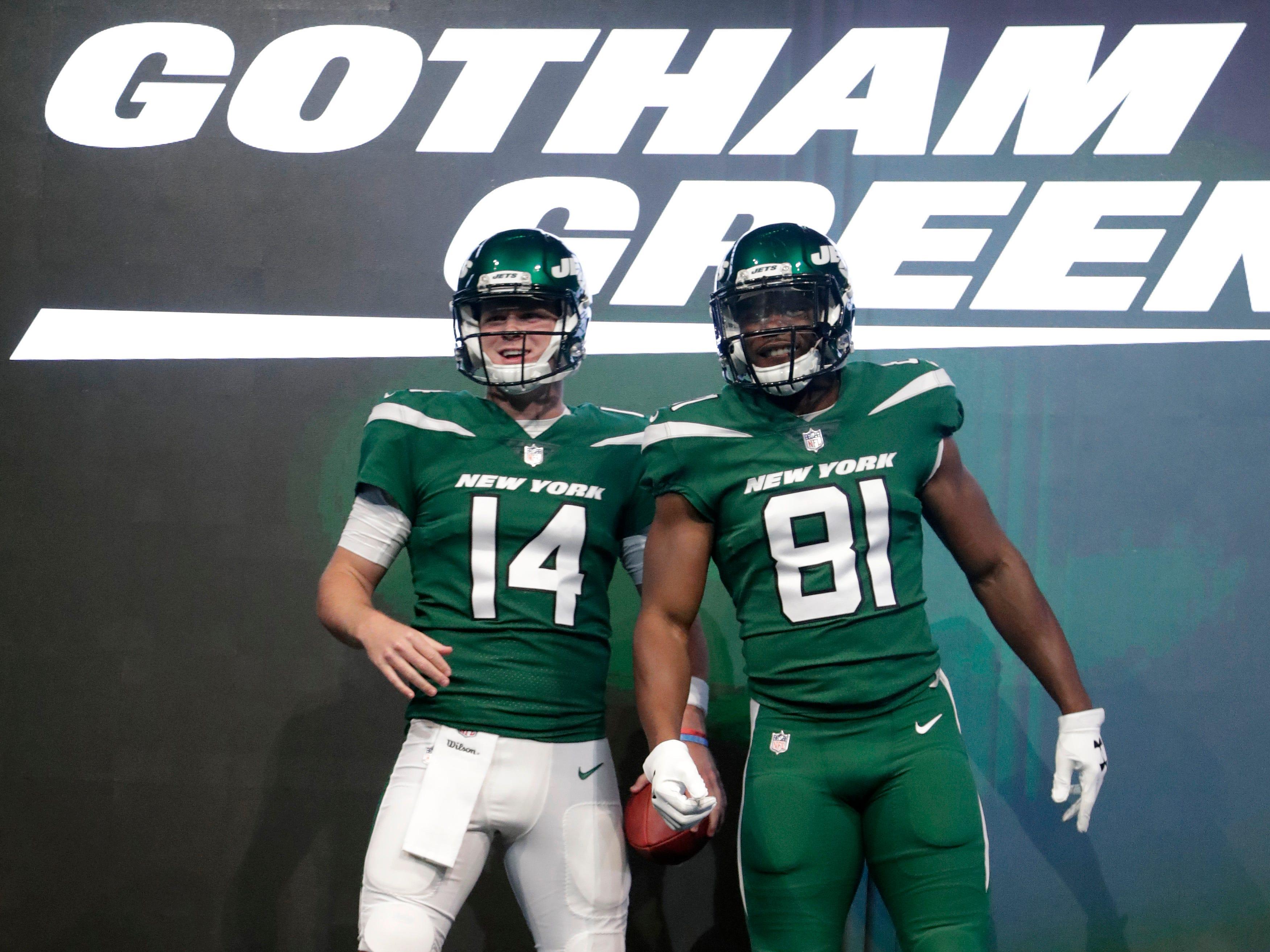 "New York Jets quarterback Sam Darnold (14) and wide receiver Quincy Enunwa (81) model the  team's new ""Gotham green"" uniforms."