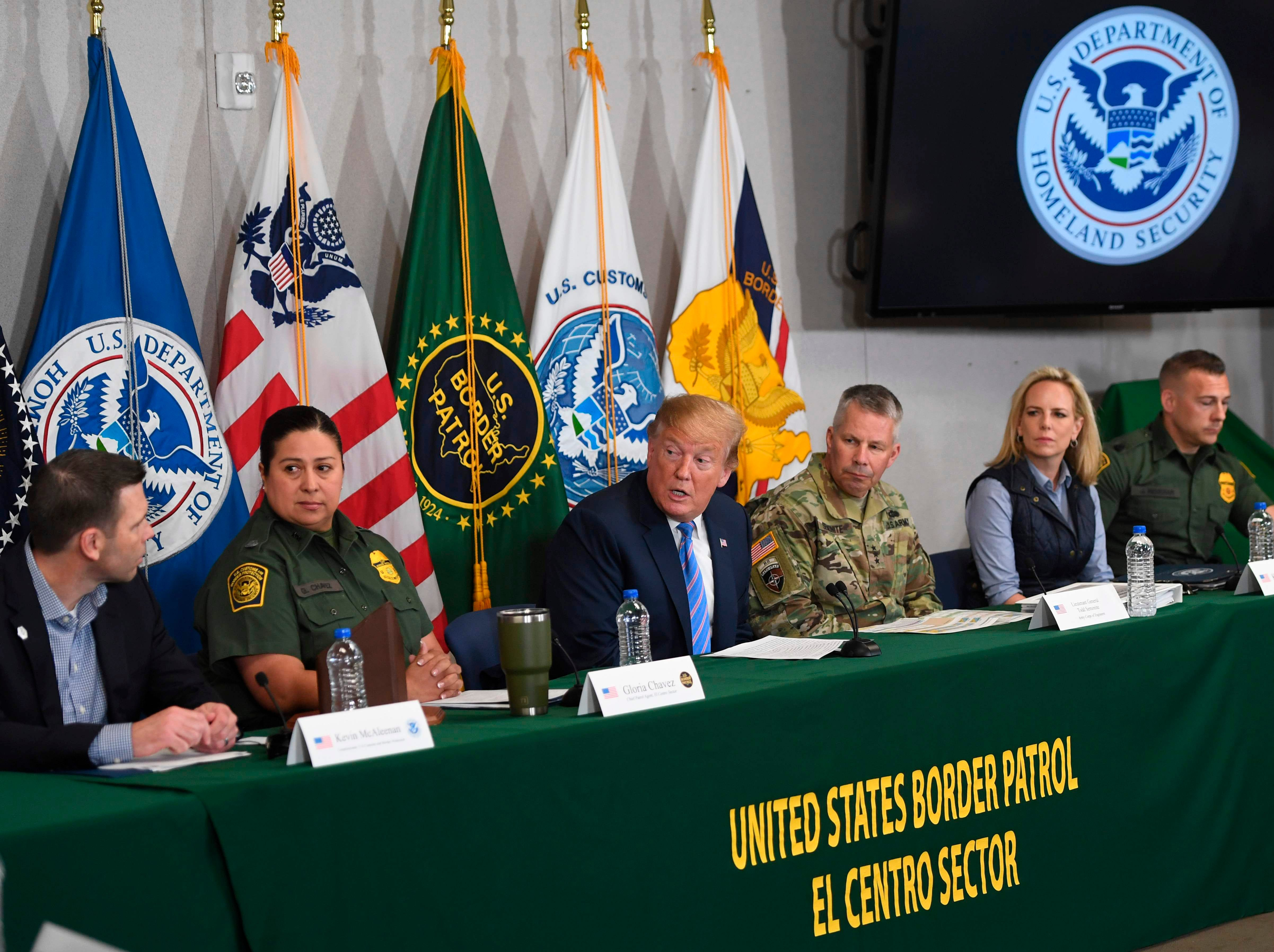 President Donald Trump speaks with members of the Border Patrol as US Secretary of Homeland Security Kirstjen Nielsen, second from right, looks on during a press conference in Calexico, Calif., April 5, 2019.