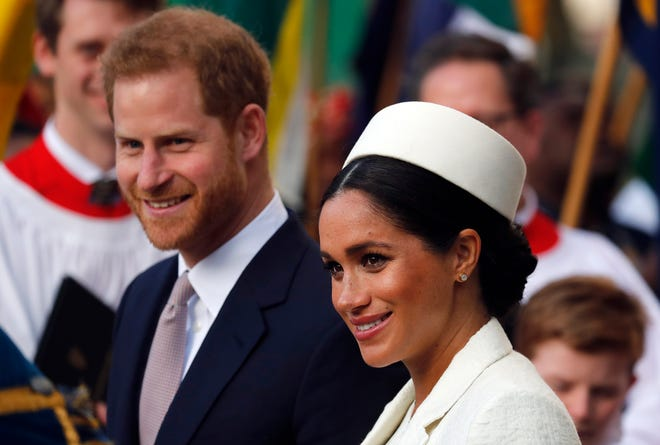 Harry and Meghan depart London's Westminster Abbey after a Commonwealth Service on March 11.