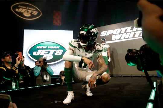 "New York Jets wide receiver Robby Anderson models the NFL football team's new ""spotlight white"" uniform Thursday, April 4, 2019, in New York."