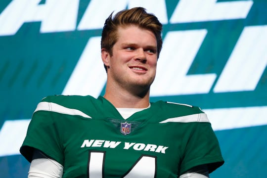 "New York Jets quarterback Sam Darnold models the NFL football team's new ""Gotham green"" uniform Thursday, April 4, 2019, in New York."