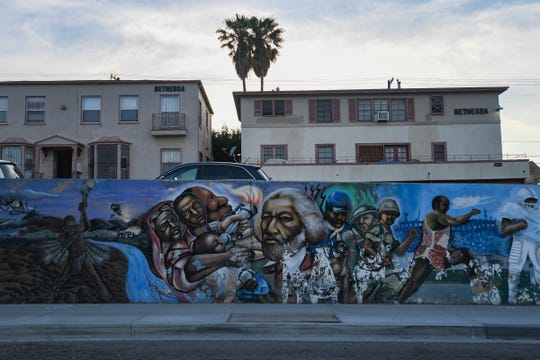A mural featuring numerous prominent African-Americans is seen on Crenshaw Blvd. in the South Los Angeles area of Southern California, on April 3, 2019.