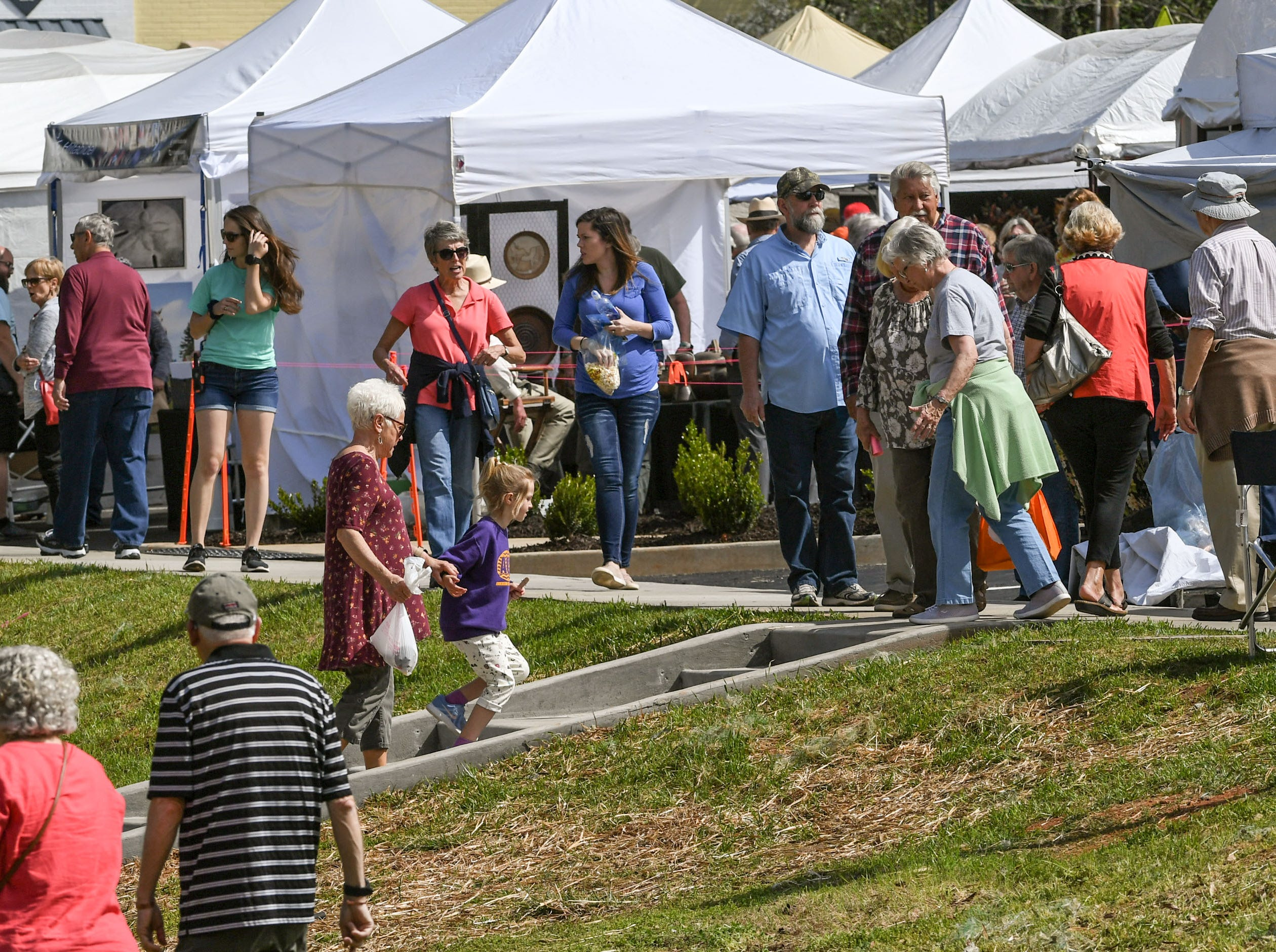 A crowd of visitors walk by artist tents and food booths during the Spring Jubilee in Historic Pendleton Saturday.