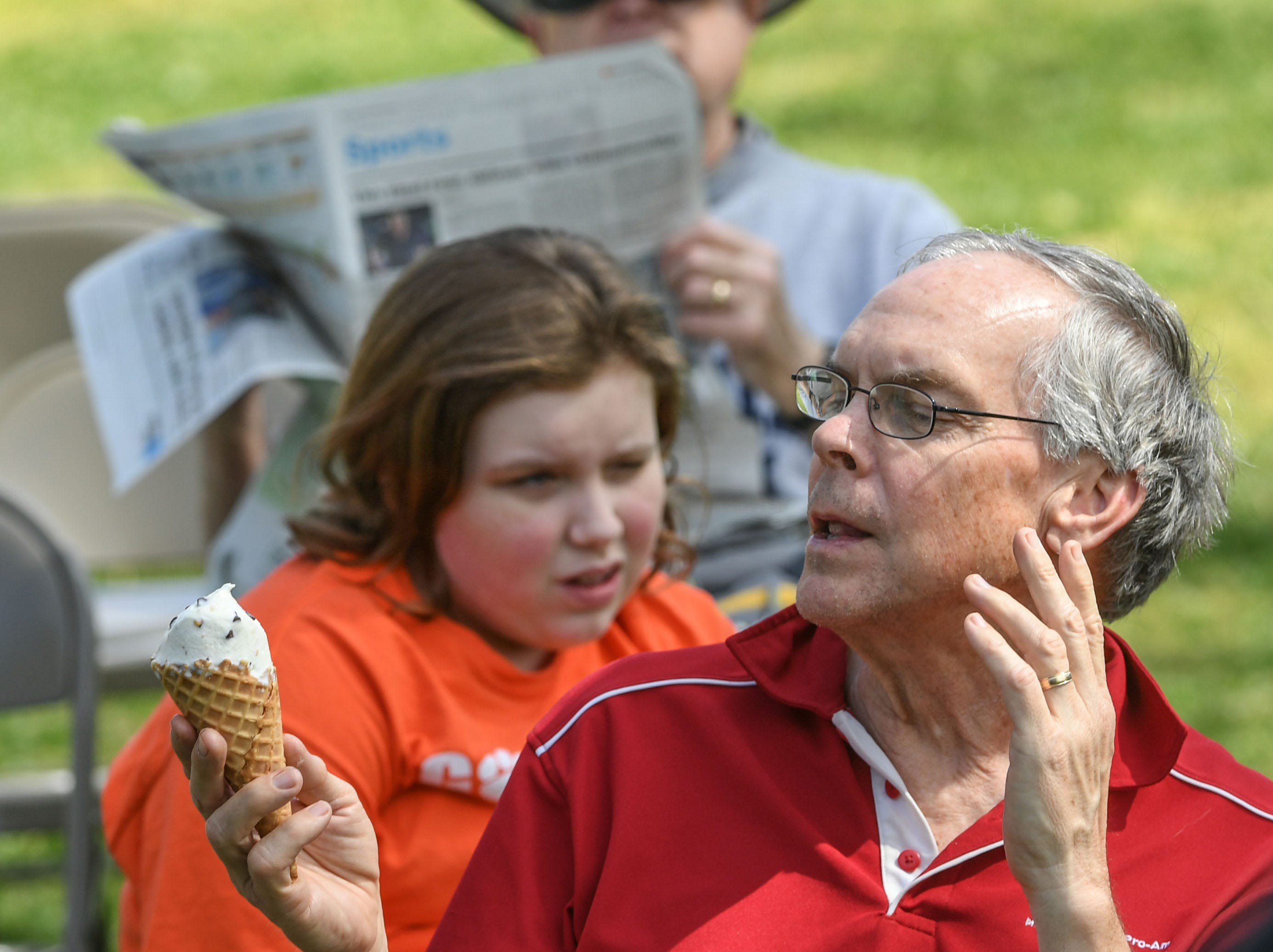 John Trice of Seneca eats an ice cream cone waiting for bluegrass band Conservation Theory to begin during the Spring Jubilee in Historic Pendleton Saturday.